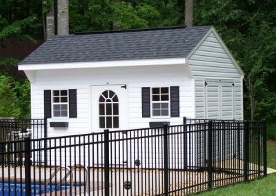 10 x 14 V-Carriage with white siding and trim, black shutters and shingles, 1' taller walls and fiberglass single door