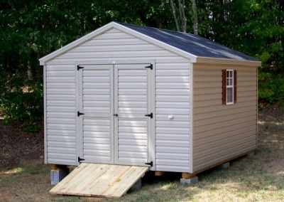 10 x 14 V-A-roof with clay siding and trim, black shingles, and redwood shutters. Wooden Ramp.