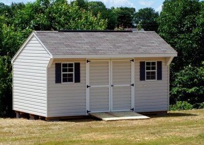 10 x 16 V-Carriage with silvermist siding, white trim, driftwood shingles, and bedford blue shutters