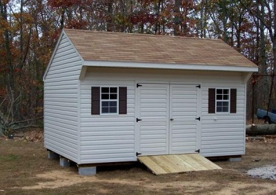12 x 16 V-Carriage with silvermist siding and trim, desert tan shingles and dark brown shutters
