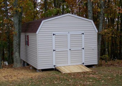 12 x 16 V-High Barn with silvermist siding, white trim, brownwood shingles, and maroon shutters