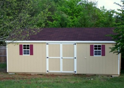 12 x 24 Painted A-roof painted a custom tan color with brownwood shingles, white trim and maroon shutters