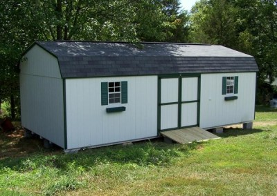 14 x 28 Painted High Barn painted white with green trim, estate gray shingles, and forest green shutters