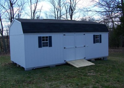 12 x 24 Painted High barn painted white with white trim, black shingles, bedford blue shutters and ridgevent