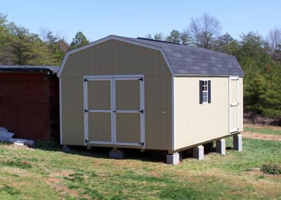 12 x 20 Painted High Barn painted leola almond with white trim, black shingles and shutters, ridgevent, and singe door