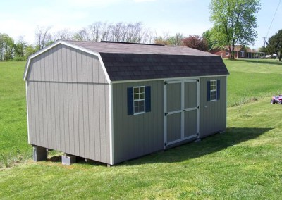 12 x 20 Painted High Barn painted clay with mist trim, driftwood shingles, bedford blue shutters, and a ridgevent