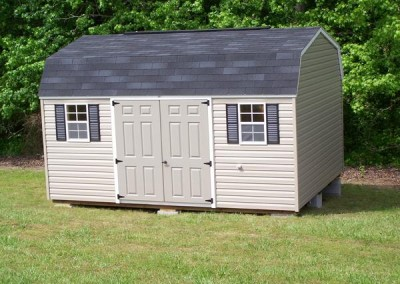 12 x 16 V-High Barn with clay siding, white trim, black shingles and shutters, and fiber doors