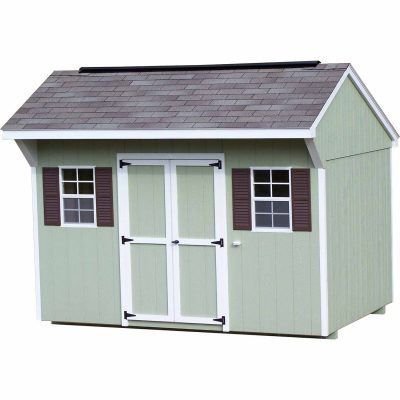 A painted shingle shed with carriage style roof. Shed has a set of double doors and two windows with shutters