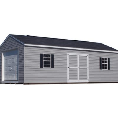 A large, gray, vinyl, shed with a black, shingled, a-roof style roof. Shed has a 10 foot ridge vent, a garage door at one end, a 6 foot wide set of solid, GGS, doors, and two windows with black shutters