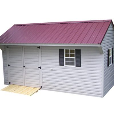 A vinyl shed with a red, metal, carriage style roof. Shed comes with two windows with black shutters, and a 6 foot set of solid, vinyl, GGS, doors, and a wooden ramp