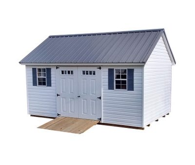 A white vinyl-ed shed with 6 foot, fiberglass door set with transom, a black metal roof, a wooden ramp, and two windows with shutters