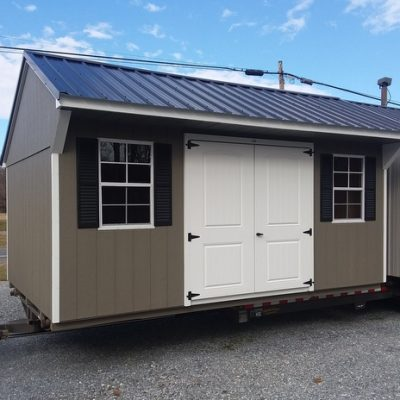"10 x 16 size painted carriage style shed with black metal roof and 6 foot fiber 2 plank double doors with two windows 24"" x 36""."