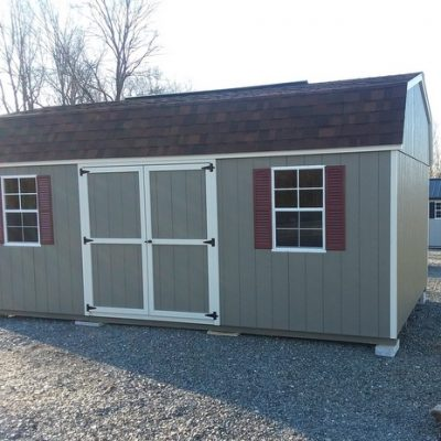 12 x 20 size painted high barn style shed with clay siding, silver mist trim, brownwood architectural shingle roof, redwood shutters, 2 12' lofts, 10' ridgevent, l p pro struct flooring, ggs 6 foot doors with two windows, silver tech smart siding.