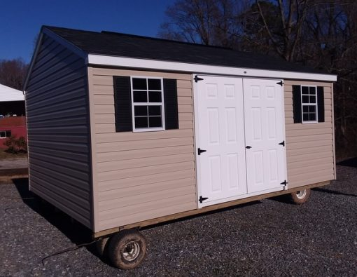 12x16 size a-roof style shed with tan siding white trim black architectural shingle roof black shutters 10' ridgevent 6' fiber double doors two windows