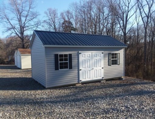 12 x 20 size vinyl classic style shed with flint siding, white trim, black metal roof, black shutters, 2 12' lofts, 1' foot taller walls, l p pro struct flooring, 6 foot fiber doors, tech shield radiant barrier on the walls, two windows.