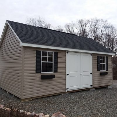 12 x 20 size vinyl garden style shed with clay siding, white trim, black architectural shingle roof, black shutters, 2 black flower boxes, 1 12' workbench, 1 12' loft, 10' ridgevent, 6 foot fiber 2 plank doors, tech shield radiant barrier on the walls, two windows.