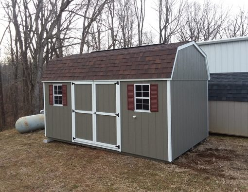 10 x 16 size painted high barn style shed with clay siding, white trim, brownwood architectural shingle roof, redwood shutters, 1 10' loft, 1 10' workbench, 10' ridgevent, l p pro struct flooring, ggs 6 foot doors, two windows.