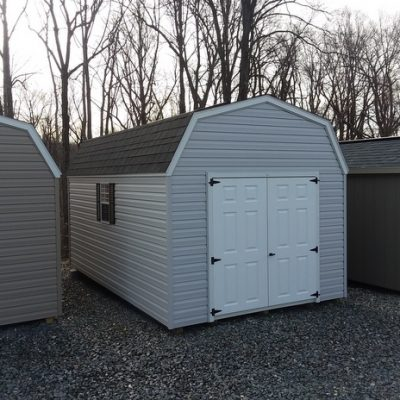 10 x 16 size vinyl high barn style shed with gray siding, white trim, black architectural shingle roof, black shutters, 10' workbench, 10' loft, 10' ridgevent, l p pro struct flooring, 6 foot fiber doors with two windows.