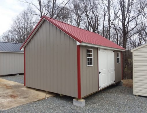 12x16 size metal garden style shed with taupe metal siding, rustic red metal roof, corners and j channel and 6 foot fiber 2 plank doors with two windows