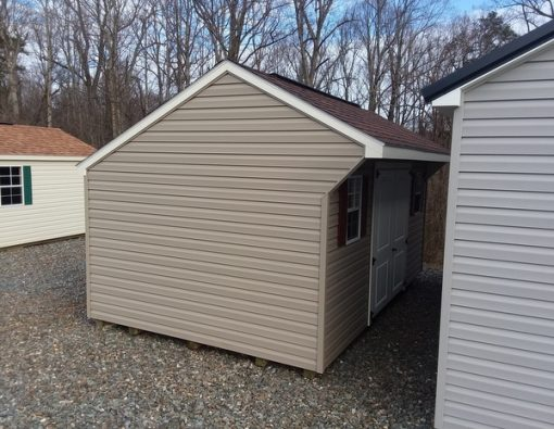 10 x 16 size vinyl carriage style shed with clay siding, pearl/ivory trim, brownwood architectural shingle roof, redwood shutters. 10' ridgevent, 6 foot 2 plank fiber doors, tech shield radiant barrier on the walls, l p pro struct flooring, two windows.