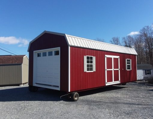 14 x 28 size painted high barn garage style shed with pinnacle red siding, white trim, gray metal roof, gray shutters, 1 14' loft, l p pro struct flooring, garage doors with glass, ggs 6 foot doors, two windows.