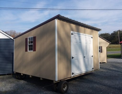 12x12 size painted econommy style shed with tan siding, white trim, brown metal roof, redwood shutters, 12' workbench and 6 foot fiber doors with two windows