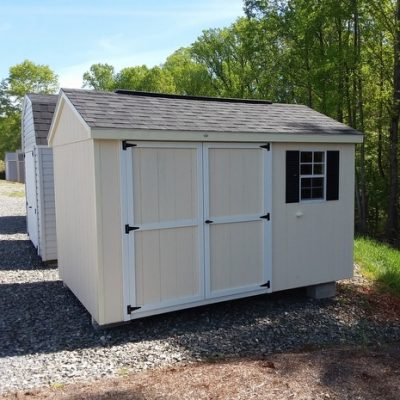 8 x 12 size painted a-roof style shed with navajo white siding, cream trim, white trim around doors, black architectural shingle roof, black shutters, 8' ridgevent, 6 foot ggs doors, with one window.