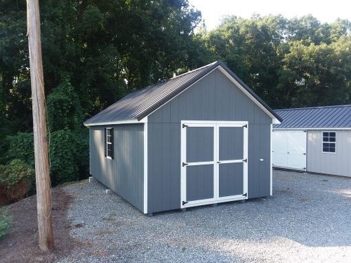 12 x 20 size painted garden style shed with dark gray siding, white trim, black metal roof, black shutters, 1 12' loft, l p pro struct flooring, ggs 6 foot doors with two windows.