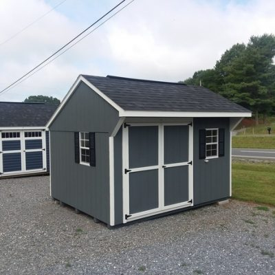 10 x 12 size painted carriage style shed with dark gray siding, white trim, black architectural shingle roof, black shutters, 8' ridgevent, l p pro struct flooring, ggs 6 foot doors, two windows.