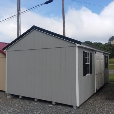 12 x 20 size painted a-roof style shed with gap gray siding, white trim, black metal roof, black shutters, fiber 6 foot doors, 12' workbench, two windows.