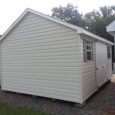 12 x 16 size vinyl classic style shed with almond siding, white trim, estate gray architectural shingle roof, gray shutters. (1) 12' workbench, 8' ridgevent, 6 foot fiber double doors, two windows.