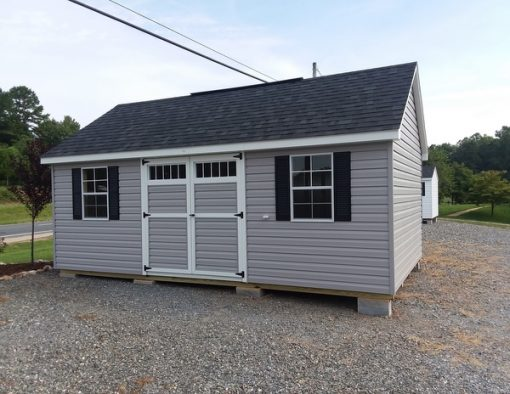 12 x 20 size vinyl garden style shed with flint siding, white trim, black architectural shingle roof, black shutters. (1) 12' loft, (1) 12' workbench, 8' ridgevent, tech shield radiant barrier on the walls, 6 foot ggs transom doors, with two windows.
