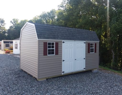 10 x 16 size vinyl high barn style shed with clay siding, white trim, estate gray architectural shingle roof, redwood shutters. (2) 10' lofts, (1) 10' workbench, 8' ridgevent, 6 foot double doors, two windows.