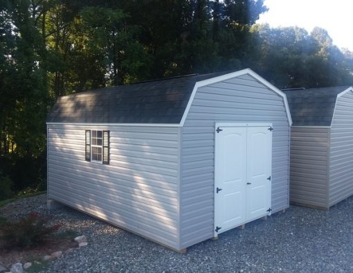 12 x 16 size vinyl high barn style shed with flint siding, white trim, black architectural shingle roof, black shutters. (1) 12' loft, (1) 12' workbench, 8' ridgevent, l p pro struct flooring, 6 foot 2 plank double doors, two windows.