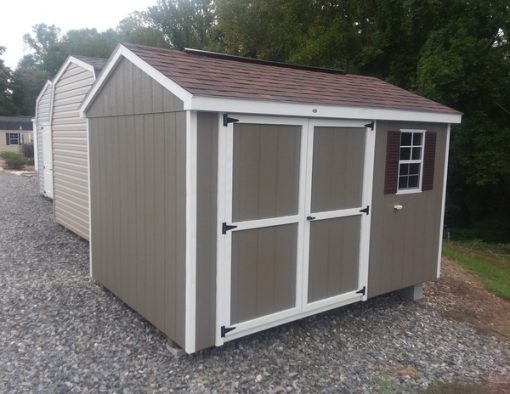 8 x 12 size painted a-roof style shed with clay siding, white trim, brownwood architectural shingle roof, brown shutters, 8' ridgevent, ggs 6 foot doors, one window.