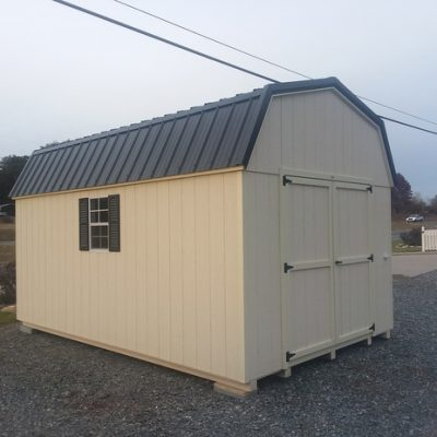 10 x 16 size painted high barn style shed with navajo white siding, cream trim, black metal roof, black shutters, 1 10' loft, 1 10' workbench, ggs 6 foot doors, two windows.