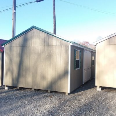 12 x 20 size painted a-roof style shed with clay siding, white trim, forest green metal roof, forest shutters, fiber 6 foot 2 plank double doors, 12' workbench, l p pro struct flooring, two windows.