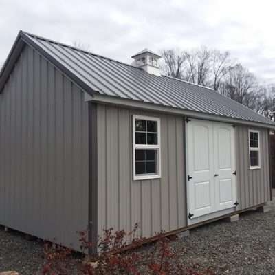 "12x20 size Metal Garden style shed with Gray siding, charcoal metal roof, tech shield radiant barrier on walls 2x6x12 o.c. floor joists, l p pro struct flooring, cupola 21"" window style, 6 foot fiber doors with two insulated windows"