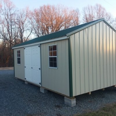 12x20 size Metal A-Roof style shed with light stone siding, hunter green metal roof, corners and j channel, 12' workbench, 6 foot fiber doors with two windows