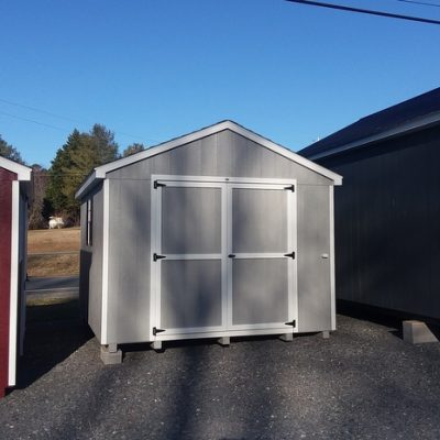 10 x 12 size painted a-roof style shed with gap gray siding, white trim, black architectural shingle roof, black shutters, 8' ridgevent, ggs 6 foot doors with two windows.