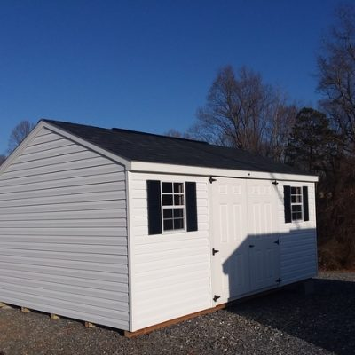 12 x 16 size vinyl a-roof style shed with white siding, white trim, black arch shingle roof, black shutters. (1) 12' workbench, tech shield radiant barrier on the walls, l p pro struct flooring, 8' ridgevent, 6 foot fiber doors, with two windows.