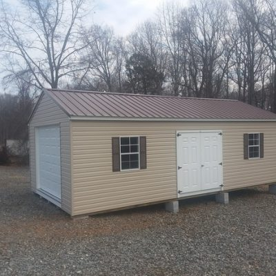 14 x 28 size vinyl a-roof garage style shed with tan siding, white trim, brown metal roof, brown shutters, 14' loft, 14' workbench, plywood on walls, preformmax flooring, 6 foot fiber doors with two windows.