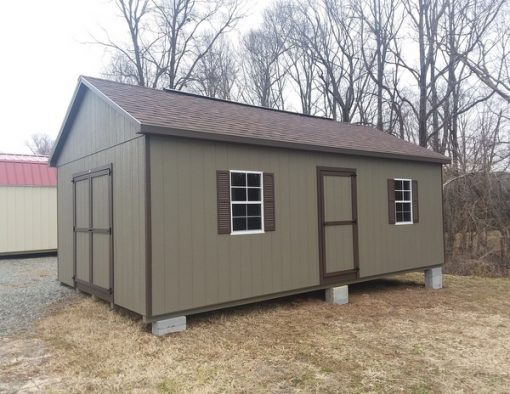 14 x 24 size painted classic style shed with clay siding, brown trim, brownwood architectural shingle roof, brown shutters, 16' ridgevent, 14' workbench' 14' loft custom height, ft taller walls, ggs 3 foot door, ggs 6 foot doors, four windows.