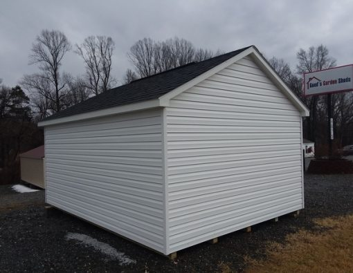 12x16 size vinyl classic style shed with white siding, white trim, black arch shingle roof, black shutters, 8' ridge vent and 6 foot fiber doors with two windows