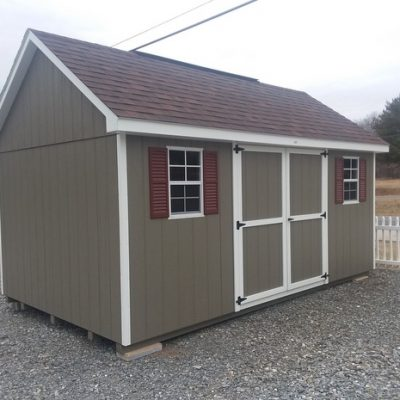 10 x 16 size painted garden style shed with clay siding, white trim, brownwood architectural shingle roof, rewdwood shutters, 10' loft, 8' ridgevent, ggs 6 foot doors, two windows.