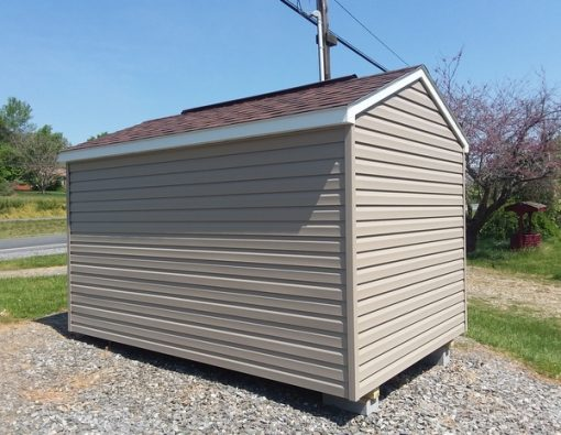 8x12 size vinyl a-roof style shed with clay siding, white trim, brownwood arch shingle roof, burgundy shutters, 8' ridgevent and 6 foot fiber doors with one window
