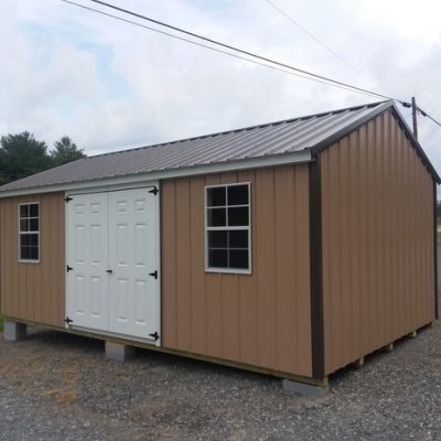 12x20 size metal a-roof style shed with tan metal siding, burnished slate metal roof, corners and j channel and 6 foot fiber doors with two windows